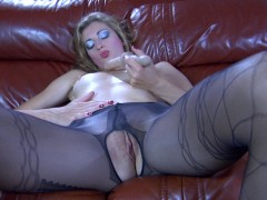 ferro network Slutty blonde in stocking effect tights and red pumps using a rubber cock: Wearing nothing but her mock suspender nylons tights and scarlet high heels, Fiona A is playing with her big sword-like dildo while lying on the big brown couch. This horny curlyhead will give her rubber cock a good lick before sliding it into her hot moist beaver. Watch her spread-eagling and getting on all fours while drilling her wet hole through the open crotch of her pantyhose.video
